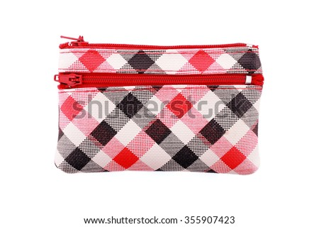 It is Multipurpose colorful checked bag isolated on white. - stock photo