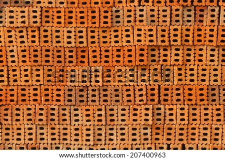 It is pile of orange bricks for pattern and construction. - stock photo
