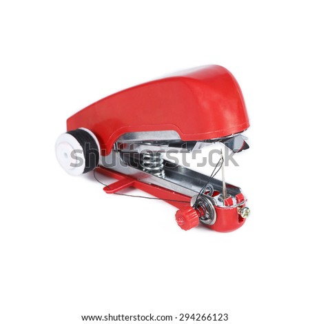 It is Red handheld sewing machine isolated on white. - stock photo