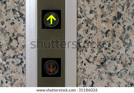 It is the elevator button of up sign. - stock photo