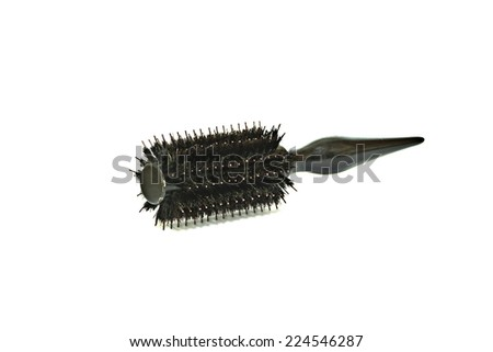 It is Used black rolling comb with hair isolated on white background. - stock photo