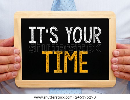 It is your TIME - Businessman with blackboard - stock photo