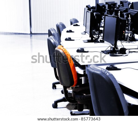IT room with computers in row - stock photo