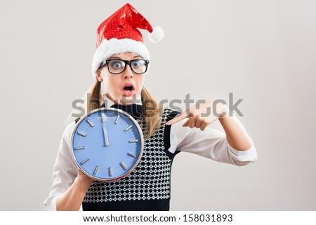 It`s a midnight and the new year is here,nerdy woman is in panic because new problems are coming.Is she strong enough to solve them?!Nerdy woman in panic - stock photo