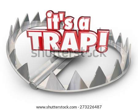 It's a Trap word in red 3d letters on a steel bear trap to illustrate a dangerous trick, scam or bad situation - stock photo