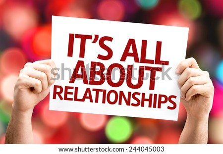 It's All About Relationships card with colorful background with defocused lights - stock photo