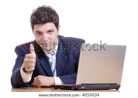 It's all good-Businessman working on a computer with his thumb up - stock photo