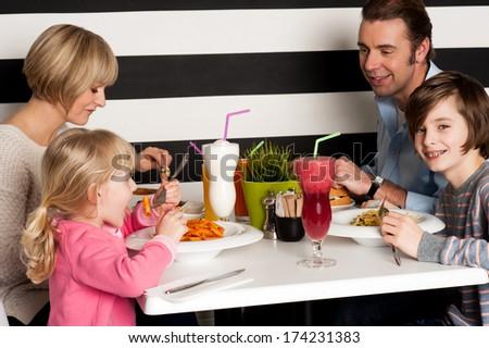 It's celebration time, family toasting smoothies. - stock photo