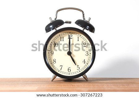 It's five o'clock already. Time to wake up and hurry. An image of a retro clock showing 05:00 am or pm. - stock photo