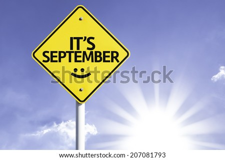 It's September road sign with sun background  - stock photo