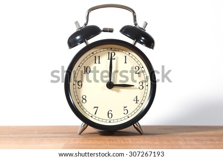 It's three o'clock already. Time to wake up and hurry. An image of a retro clock showing 03:00 am or pm. - stock photo