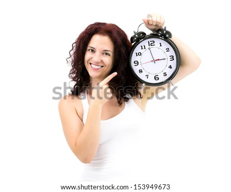 It's Time for... Adorable Smiling Young Woman holding huge heavy retro style clock. Studio shot on white background - stock photo