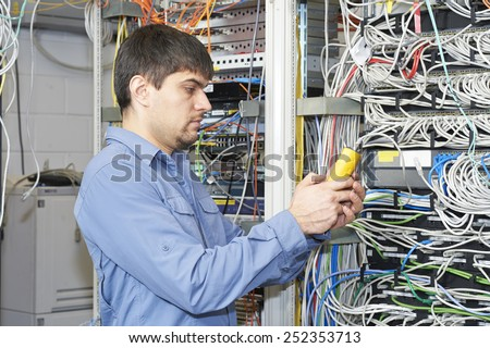 IT specialist holds in his hands network scanner - stock photo