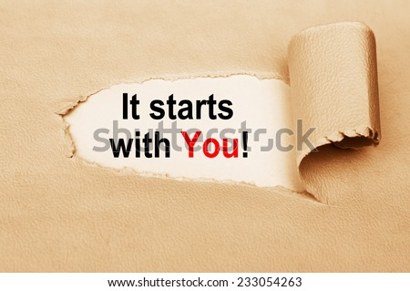 It Starts With You written behind a torn paper - stock photo