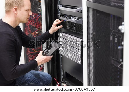 It technician maintain servers an SAN in datacenter - stock photo
