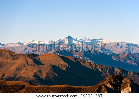 Italian alps in Veneto and Trentino. In the foreground the Monte Baldo (Baldo Mountain) and in the background the group of Adamello seen from the plateau of lessinia - stock photo