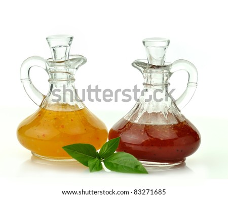 italian and raspberry vinaigrette salad dressings in glass bottles - stock photo