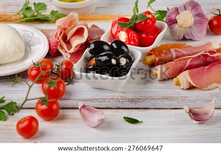italian appetizer - Mixed Antipasto on a wooden table . Selective focus - stock photo