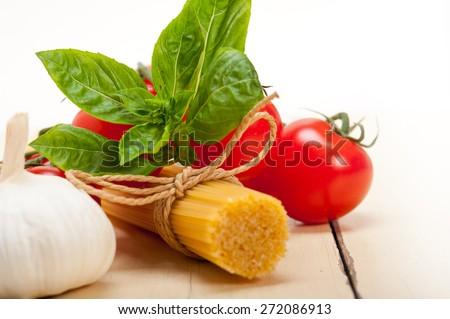 Italian basic pasta fresh ingredients cherry tomatoes garlic and basil - stock photo