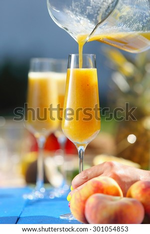 Italian Bellini alcoholic cocktail with peach   - stock photo