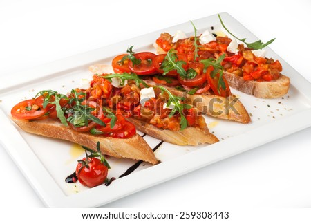 Italian Bruschetta Appetizer on the white plate - stock photo