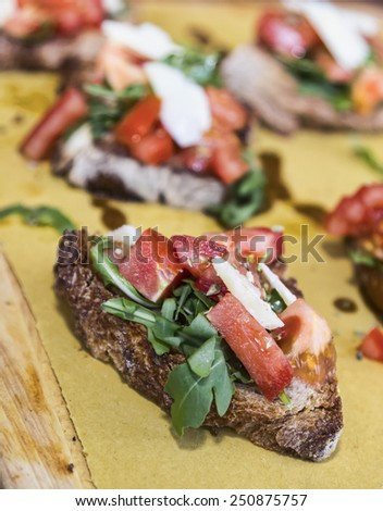 Italian bruschetta with fresh tomatoes,mozzarella,garlic,basil and olive oil. - stock photo