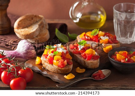 Italian bruschetta with tomatoes garlic olive oil  - stock photo