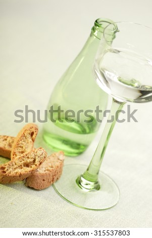 Italian cantuccini with glas of water - stock photo