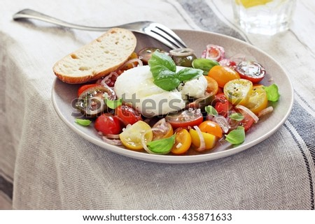 Italian caprese salad with tomatoes,mozzarella and basil. Selective focus - stock photo