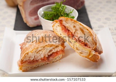Italian ciabatta panini sandwich with parma ham and tomato - stock photo