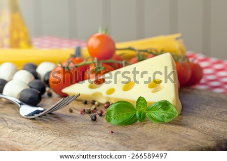 Italian classic ingredients for pasta with cheese, spaghetti and vegetables. Shallow depth of field. - stock photo