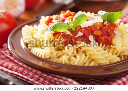 italian classic pasta fusilli with tomato sauce and basil - stock photo