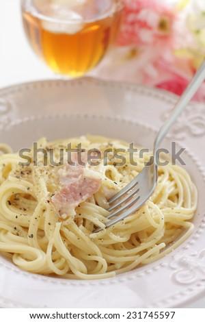 Italian cuisine, bacon and black pepper cream spaghetti - stock photo