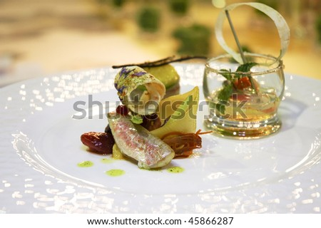italian cuisine, fillet of fish served in a decorated dish for a gastronomic competition - stock photo