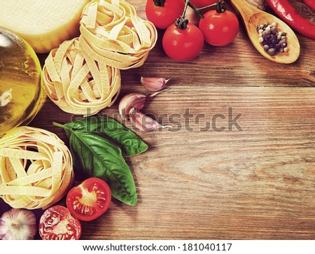 Italian cuisine. Vegetables, oil, spices and pasta on the table. Vintage retro hipster style version - stock photo