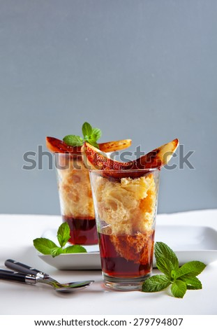 Italian dessert with wine Marsala, panettone and fried pear - stock photo