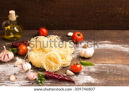 italian egg pasta with food  ingredients over rustic background - stock photo