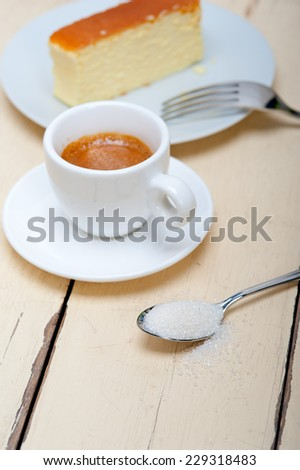 italian espresso coffee and cheese cake over white wood table - stock photo