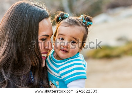 Italian family enjoying a day at the park -- taken at San Rafael Park in Reno, Nevada, USA  - stock photo