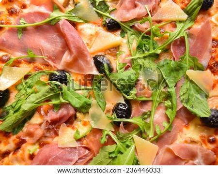 italian fast food pizza with ham cheese and arugula - stock photo