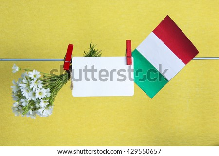Italian flag, flowers and note for text. concept for information holidays, dates and events in Italy. Information table - stock photo