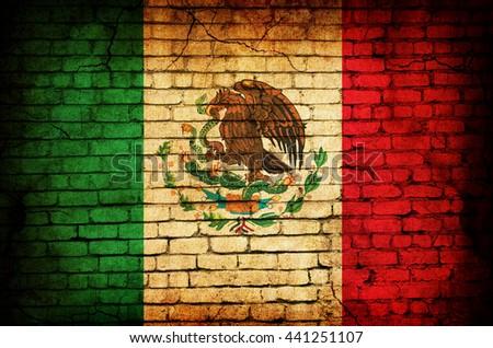Italian flag on brick wall - stock photo