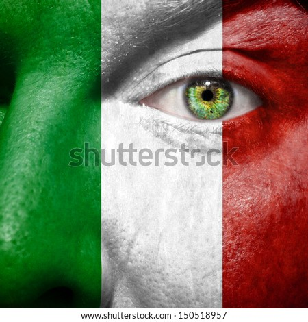 Italian flag painted on mans face to support his country Italy - stock photo