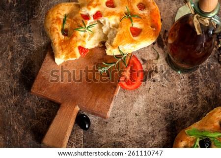 Italian Focaccia Bread on rustic board - stock photo