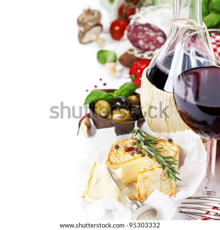 Italian food  (cheese, salami, tomatoe, garlic, pepper, mushroom, olives, olive oil, basil)  and wine over white - stock photo