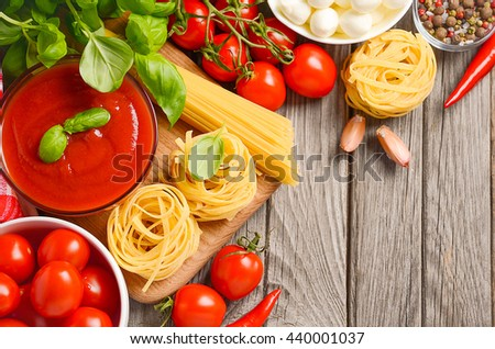 Italian food ingredients on rustic wooden background, top view, copy space - stock photo