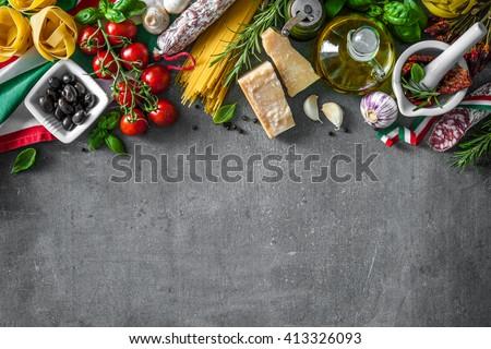 Italian food ingredients on slate background - stock photo
