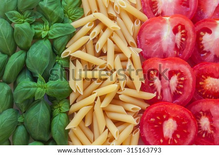 italian food with background - pasta, tomato, basil - stock photo