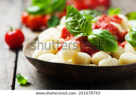 Italian gnocchi with tomato and basil, selective focus - stock photo