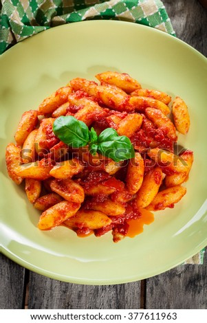 Italian gnocchi with tomato sauce on a plate - stock photo